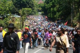 Thousands of Papuans march in a rally in Jayapura on July 8, 2010 